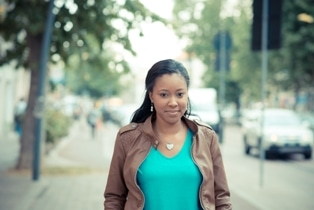 beautiful african american woman walking in the city