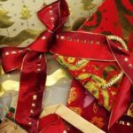 Christmas background made of christmas gifts, wrapping Paper and a bow